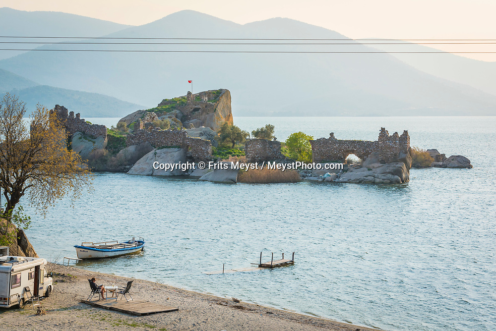 Heracleia, Kapikiri, Bafa Golu, Turkey, April 2017.  Camping on the beach of lake Bafa Golu. Lake Bafa or Lake Bafa Nature Park is a lake and a nature reserve situated in southwestern Turkey, part of it within the boundaries of Milas district of Muğla Province and the northern part within Aydın Province's Söke district. With its many small bays along the rugged  mediterranean coast, and a great safety standard, Turkey is well suited for camper tourism. Photo by Frits Meyst / MeystPhoto.com