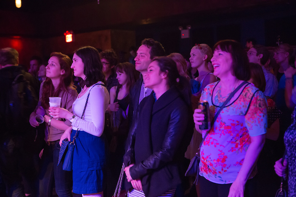 An enraptured crowd listens to The Cacuts Blossoms play western music.