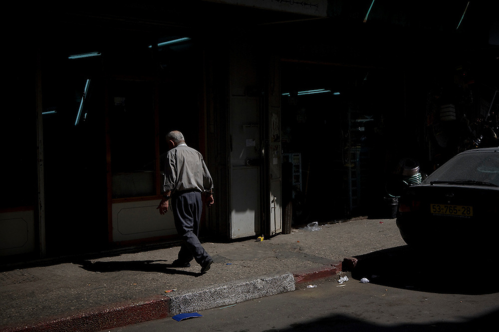 A Palestinian shopkeeper in the West Bank city of Ramallah. 13th May 2008