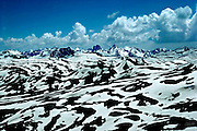 """Mountain peaks of the """"The Serious WIld"""" rise  more than 14,000 feet above sea level and loom over the melting snowfields of the Continental Divide between Silverton and Durango, Colorado ."""