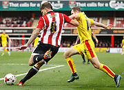 Brentford defender Harlee Dean gets the ball clear from danger during the Sky Bet Championship match between Brentford and Rotherham United at Griffin Park, London, England on 17 October 2015. Photo by Andy Walter.