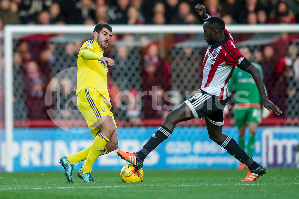 Nélson Oliveira of Nottingham Forest and Toumani Diagouraga of Brentford challenge for the ball during the Sky Bet Championship match between Brentford and Nottingham Forest at Griffin Park, London, England on 21 November 2015. Photo by Salvio Calabrese.