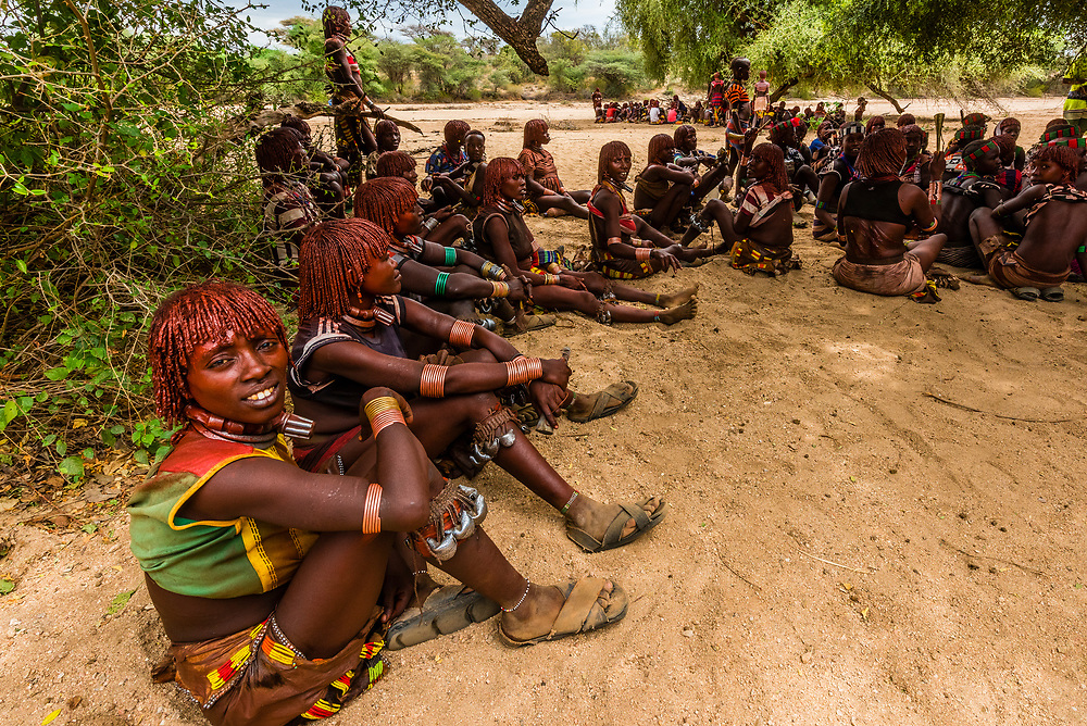 Hamer tribe people at a bull jumping ceremony, which is a rite of passage to initiate a boy into manhood. Omo Valley, Ethiopia.