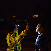 A CMPD officer performs a field sobriety test on a suspected drunk driver during an scheduled DUI checkpoint in West Charlotte.
