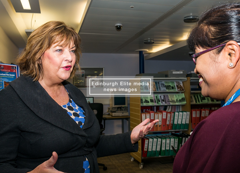 Pictured: Scottish Government Public Libraries Funding Announcement. Culture Minister Fiona Hyslop announces this year's successful bids to the £450,000 Public Library Improvement Fund (PLIF) at the John Grey Centre, Haddington Library, Haddington, East Lothian, Scotland, United Kingdom.  PLIF has been supporting innovative library projects since 2006 which help both individuals and communities. Fiona Hyslop meets Dr Hanita Ritchie, Local History Officer and organiser of Haddington Film Appreciation Club. 13 December 2018  <br /> <br /> Sally Anderson | EdinburghElitemedia.co.uk