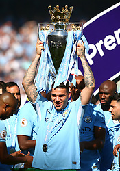Manchester City goalkeeper Ederson celebrates with the Premier League Trophy