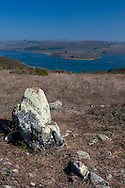 A large lichen-covered stone stands overlooking Tomales Bay, Point Reyes National Seashore