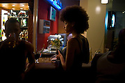 Models Elarica Gallacher (r) and Parris Taylor kill time in the hotel lobby bar while waiting for a venue power outage to be resolved prior to the July 11, 2008 leg of the THISDAY festival in Abuja, Nigeria. The annual festival is designed to raise awareness of African issues while promoting positive images of Africa using music, fashion and culture in a series of concerts and events in Nigeria, the United States and the United Kingdom. .