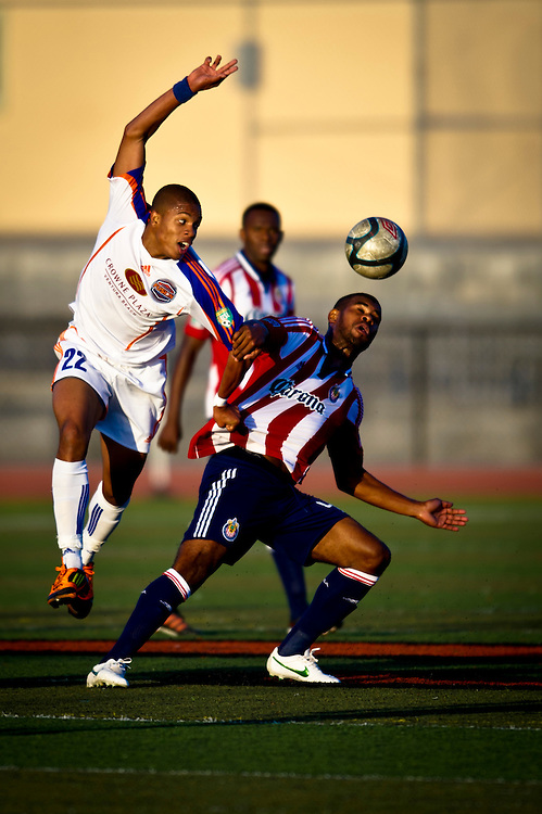 Trovis Bowen of the Ventura County Fusion scrambles past a Chivas USA defender during a match at Ventura College in Ventura Calif., on May 29, 2012.  Chivas went on to win the game 1-0.  (Photo by Aaron Schmidt © 2012)