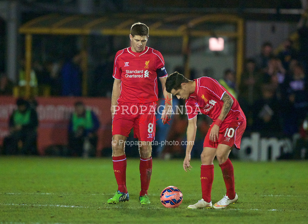 KINGSTON-UPON-THAMES, ENGLAND - Monday, January 5, 2015: Liverpool's captain Steven Gerrard and Philippe Coutinho Correia look dejected as AFC Wimbledon score the opening goal during the FA Cup 3rd Round match at the Kingsmeadow Stadium. (Pic by David Rawcliffe/Propaganda)
