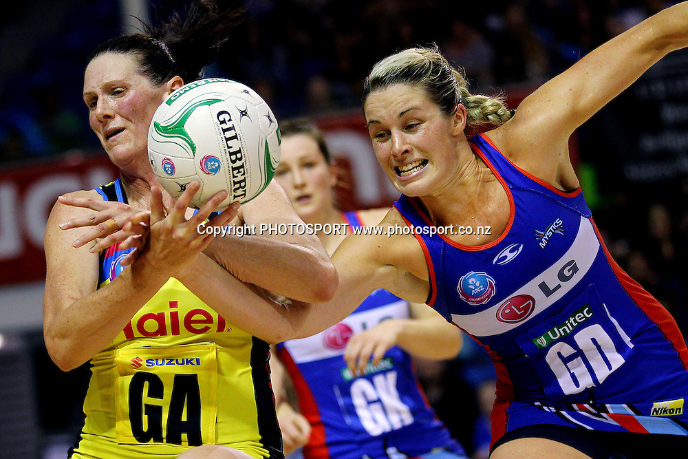 Mystics' Julie Corletto goes for the intercept against Pulse's Donna Wilkins. ANZ Netball Championship, Northern Mystics v Central Pulse, Trusts Stadium, Auckland, New Zealand. Sunday 21st April 2013. Photo: Anthony Au-Yeung / photosport.co.nz