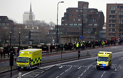 © Licensed to London News Pictures. 16/01/2013. London, UK People from nearby businesses and building were evacuated over Vauxhall Bridge. A damaged crane is seen hanging from the side of the St George's Wharf development near Vauxhall in in London today (16/01/13) after a being hit by a helicopter, which then crashed.  Photo credit : Stephen Simpson/LNP