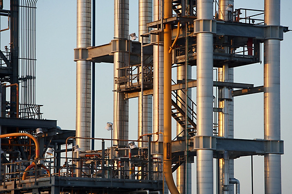 Stock photo of chemical plant pipes at sunset
