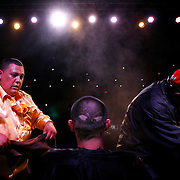 TP_301484_ALLE_Hair_03.WILLIE J. ALLEN JR. | Times.(Tampa).Barber Johnny Sanchez, 32 puts the finishing touches on the head of Omar Malic during the Barber competition at the Platinum Plus Hair Studio Hair and Barber competition at the Historic Ritz Theater in Tampa on Sunday evening.