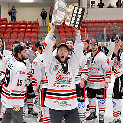FORT FRANCES, ON - May 2, 2015 : Central Canadian Junior &quot;A&quot; Championship, game action between the Fort Frances Lakers and the Soo Thunderbirds, Championship game of the Dudley Hewitt Cup. Connor Dea #25 of the Soo Thunderbirds raises the Dudley Hewitt Cup..<br /> (Photo by Shawn Muir / OJHL Images)