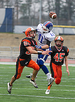 Interlakes Collin Sheehan guarded by Newport's Stephan Nix and Tyler Sharron for an incomplete pass during Sunday's state championship NHIAA Division III football at UNH.    (Karen Bobotas/for the Laconia Daily Sun)