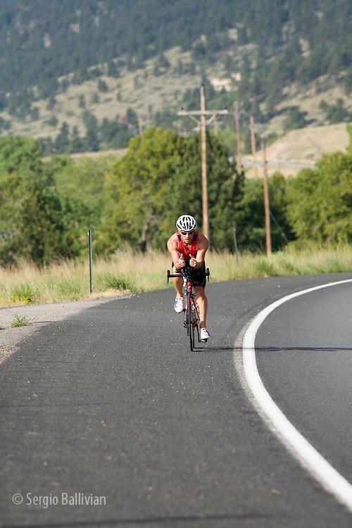 Dmitry Yesilevski trains on his road bike for a triathlon near Boulder, Colorado.