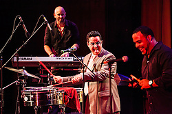 Tito Puente, Jr. and his Orchestra perform at the Reichhold Center of the Arts.  Tito Puente, Jr. like his father is known for the passion he exudes while playing.  Puente's performance marks 25 years and 3 days since his father, renowned Latin jazz and salsa musician performed on this same stage for a Virgin Islands audience.  Tito Puente, Jr. nurtures his father's musical legacy by performing the classic compostions for which he was known.  throughout © Aisha-Zakiya Boyd
