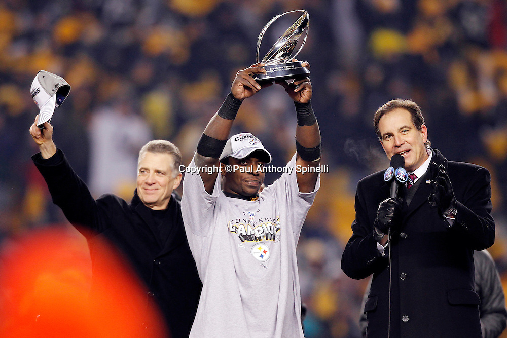 Pittsburgh Steelers running back Rashard Mendenhall (34) holds up the AFC Champion Lamar Hunt Trophy during the postgame award ceremony after winning the NFL 2011 AFC Championship playoff football game against the New York Jets on Sunday, January 23, 2011 in Pittsburgh, Pennsylvania. The Steelers won the game 24-19. (©Paul Anthony Spinelli)