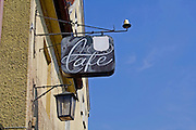 cafe sign on wall with lamp