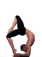 caucasian man Eka Pada Viparita Dandasana One-legged Inverted Staff  pose stretch acrobatics yoga balance posture isolated studio on white background