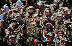 "KABUL,AFGHANISTAN - SEPT. 9: An Afghan police officer chants ""Allah Akbar"" or ""God is Great"" during a ceremony in Kabul Sports Stadium September 9, 2002  to comemerate the anniversary of the death of Ahmad Shah Massoud in Kabul, Afghanistan. (Photo by Ami Vitale/Getty Images)"