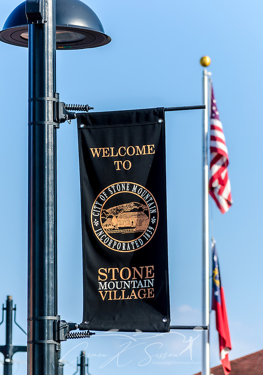 A banner welcomes visitors to Stone Mountain Village in Stone Mountain, Georgia, July 5, 2014. The village was established in 1839, and some of the buildings are more than 200 years old. Photo by Carmen K. Sisson/Cloudybright)