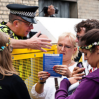 London, UK - 27 August 2012: a policeman helps visitors during the annual Notting Hill Carnival.