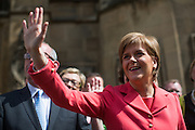 UNITED KINGDOM, London: 11 May 2015. First Minister of Scotland, Nicola Sturgeon arrives out side the House's of Parliament with all 56 newly elected Scottish National Party MP's for a photo-call. London, England. Andrew Cowie / Story Picture Agency