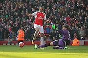 Arsenal defender, Kieran Gibbs (3) passing the ball instead of going around Watford goalkeeper, Costel Pantilimon (18) during the The FA Cup Quarter Final match between Arsenal and Watford at the Emirates Stadium, London, England on 13 March 2016. Photo by Matthew Redman.