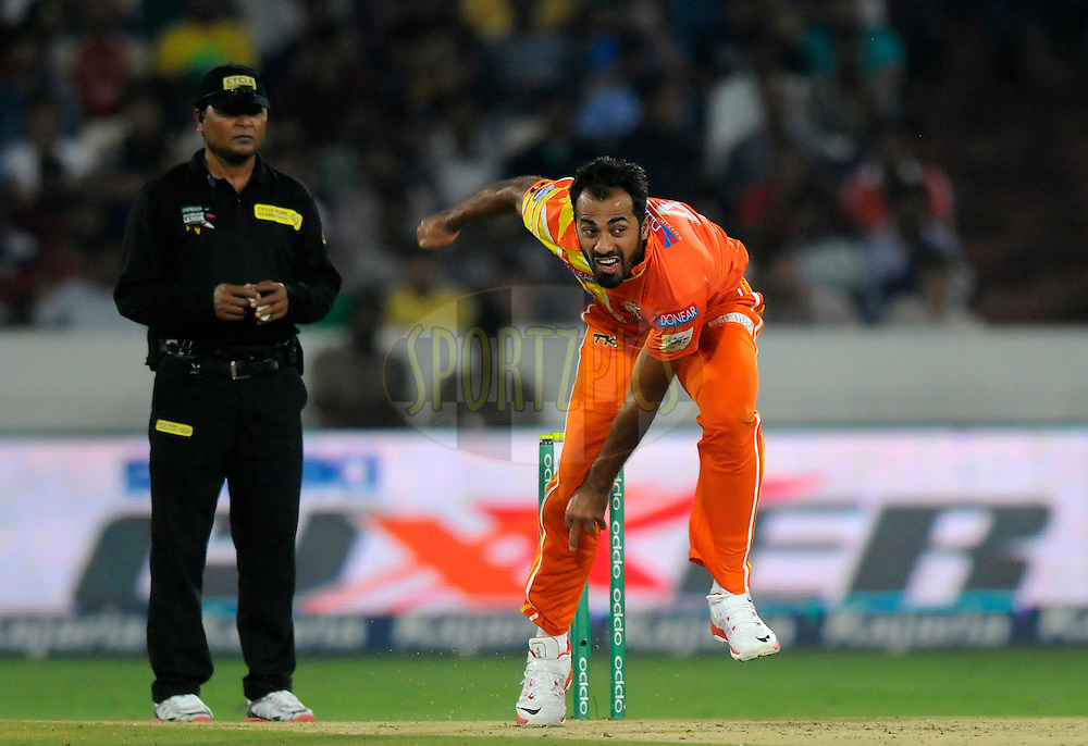 Wahab Riaz of Lahore Lions bowls during match 7 of the Oppo Champions League Twenty20 between the Kolkata Knight Riders and the Lahore Lions held at the Rajiv Gandhi Cricket Stadium, Hyderabad, India on the 21st September 2014<br /> <br /> Photo by:  Pal Pillai / Sportzpics/ CLT20<br /> <br /> <br /> Image use is subject to the terms and conditions as laid out by the BCCI/ CLT20.  The terms and conditions can be downloaded here:<br /> <br /> http://sportzpics.photoshelter.com/gallery/CLT20-Image-Terms-and-Conditions-2014/G0000IfNJn535VPU/C0000QhhKadWcjYs