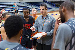 UPike Men's head basketball coach Kelly Wells, shows how to run a drill during team workouts, Wednesday, Sept. 24, 2014 at the Eastern Kentucky Expo Center and The Wells Home in Pikeville. Photo by Jonathan Palmer, Special to the CJ