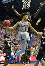 Feb 24, 2020; Lawrence, Kansas, USA; Kansas Jayhawks guard Devon Dotson (1) makes a mid-air pass during the second half against the Oklahoma State Cowboys at Allen Fieldhouse. Mandatory Credit: Denny Medley-USA TODAY Sports
