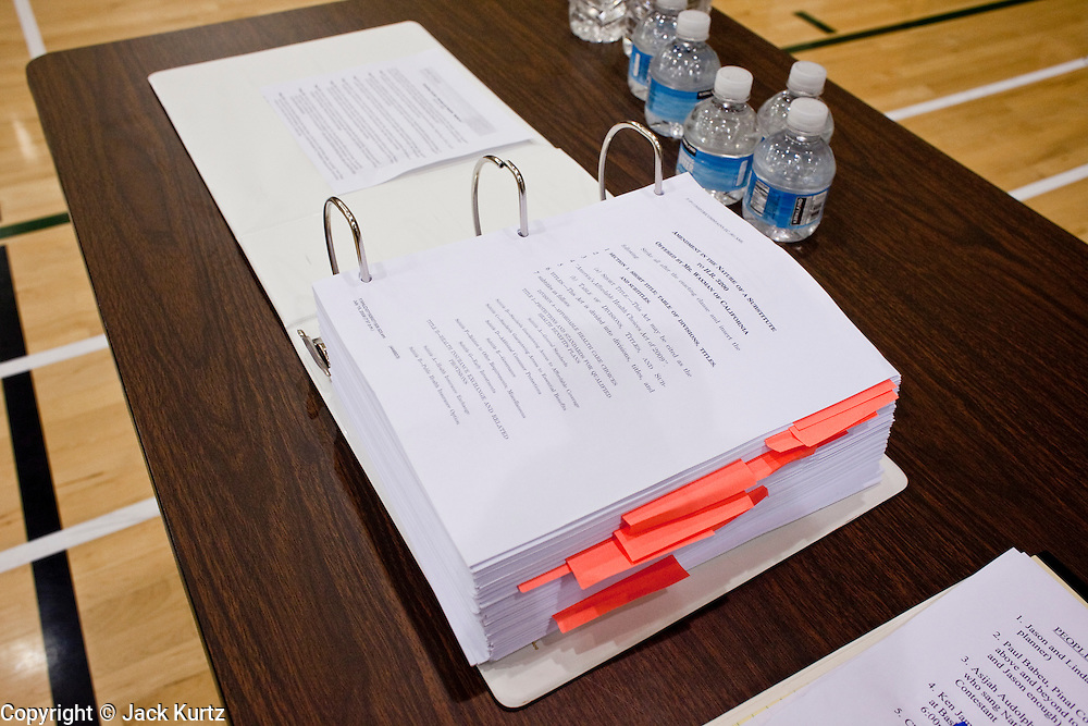 "Aug 10, 2009 -- CHANDLER, AZ: Copies of the health care reform bill on a table in a health care reform town hall meeting in Chandler, AZ. Rep. Jeff Flake, (R-AZ) hosted a ""town hall"" style meeting on health care reform at Basha High School in Chandler Monday. Flake, a conservative Republican, has opposed President Obama on many issues, like the stimulus and health care reform. Protestors who have shut down similar meetings hosted by Democrats, gave Flake a warm welome. About 1,600 people attended the meeting.   Photo by Jack Kurtz"