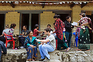 Volunteers, including nurse Daniel Danilczyk (center) record patients' medical-intake assessment, check blood pressure and blood sugar and forward them on to physicians and dentists at the Himalayan Family Healthcare Project medical camp in Tilche, Nepal.