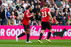 Memphis Depay of Manchester United celebrates after Juan Mata (not pictured) scores a goal to make it 0-1 - Mandatory byline: Rogan Thomson/JMP - 07966 386802 - 30/08/2015 - FOOTBALL - Liberty Stadium - Swansea, Wales - Swansea City v Manchester United - Barclays Premier League.