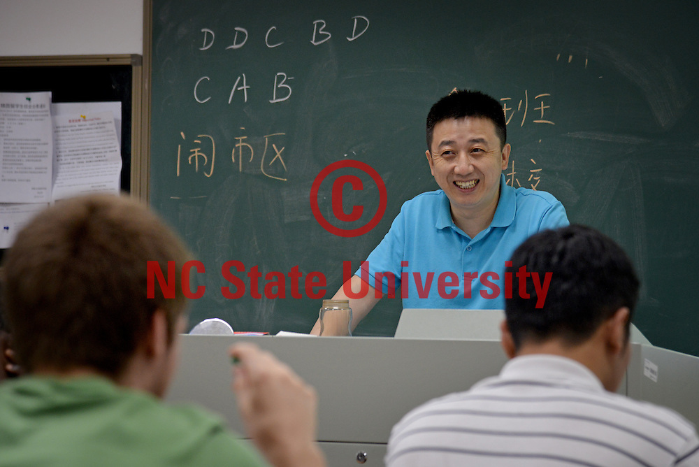 Nanjing University language instructor chuckles during a class discussion.