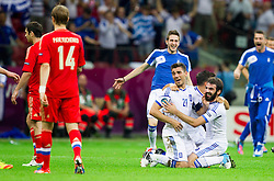 Kostas Katsouranis  of Greece and Grigoris Makos  of Greece celebrate after winning the UEFA EURO 2012 group A match between  Greece and Russia at The National Stadium on June 16, 2012 in Warsaw, Poland.  Greece defeated Russia 1-0 and qualified to Quarterfinals. (Photo by Vid Ponikvar / Sportida.com)