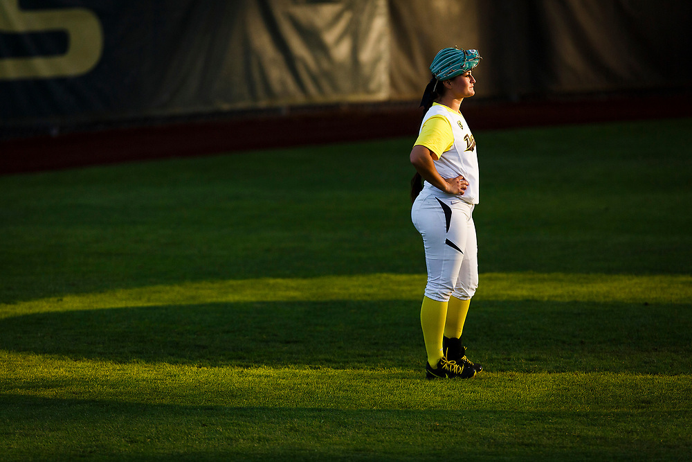 Oregon outfielder Koral Costa (7) waits for the fifth inning to start. The Oregon Ducks play the NC State Wolfpack during NCAA softball super regionals at Howe Field in Eugene, Oregon on May 22, 2015. (Ryan Kang/Emerald)
