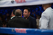Oscar De La Hoya visits with guests ringside before a fight at AT&T Stadium in Arlington, Texas on September 17, 2016.  (Cooper Neill for ESPN)