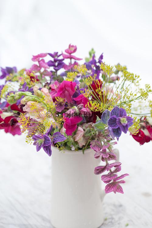 Flower arrangement with Antirrhinum majus 'Day and Night', 'Crimson Velvet' - snapdragon, Anethum graveolens - dill and Salvia viridis - annual clary