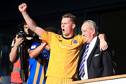 Shrewsbury Town goalkeeper Dean Henderson celebrates with Shrewsbury Town Chairman Roland Wycherley at the end of the Sky Bet League One play-off second leg match at Montgomery Waters Meadow, Shrewsbury.