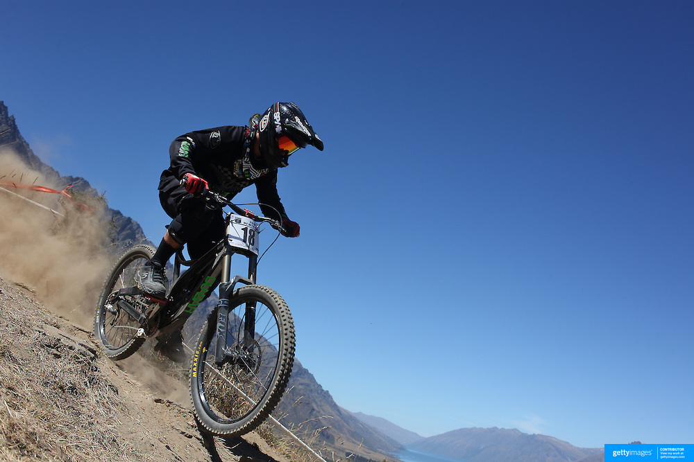 Dan Sims from Auckland in action during the New Zealand South Island Downhill Cup Mountain Bike series held on The Remarkables face with a stunning backdrop of the Wakatipu Basin. 150 riders took part in the two day event. Queenstown, Otago, New Zealand. 9th January 2012. Photo Tim Clayton