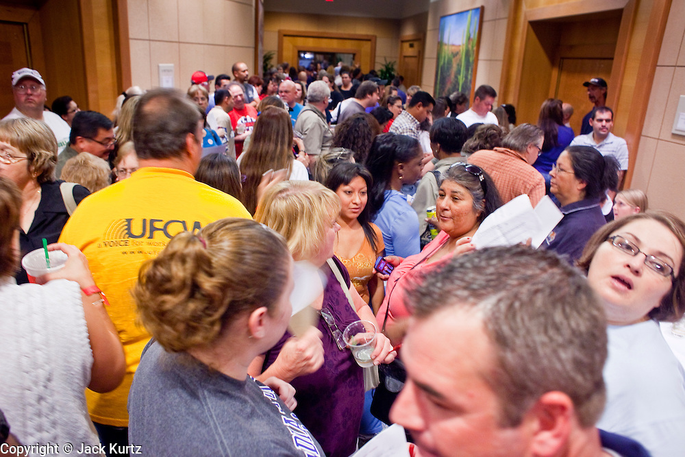 Nov. 11, 2009 -- PHOENIX, AZ: Union members gather in the lobby before a meeting of members of the UFCW at the Airport Marriott Hotel in Phoenix. The United Food and Commercial Workers Union (UFCW) Local 99 has about 25,000 members in Arizona: 15,000 in Fry's grocery stores and Fry's Marketplace, 9,500 in Safeway stores and 400 in Smith's grocery stores. The union voted down the last proposal from the stores and has announced plans to go on strike at 6PM on Friday, Nov. 13. The meeting Wednesday is the last one before the strike.   Photo by Jack Kurtz
