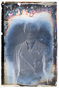 deteriorating glassplate negative with portrait of a young adult man Japan ca 1930s