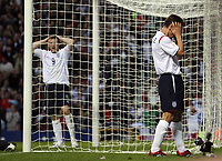 Photo: Paul Thomas.<br /> England v Macedonia. UEFA European Championships 2008 Qualifying. 07/10/2006.<br /> <br /> Gary Neville (R) of England can't believe he missed a great chance for goal as Wayne Rooney looks on.