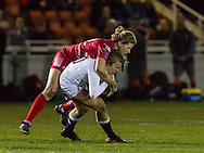 Zoe Harrison tackled by Kate Hancock, Army Women v U20 England Women at the Army Rugby Stadium, Aldershot, England, on 16th February 2017. Final score 15-38.