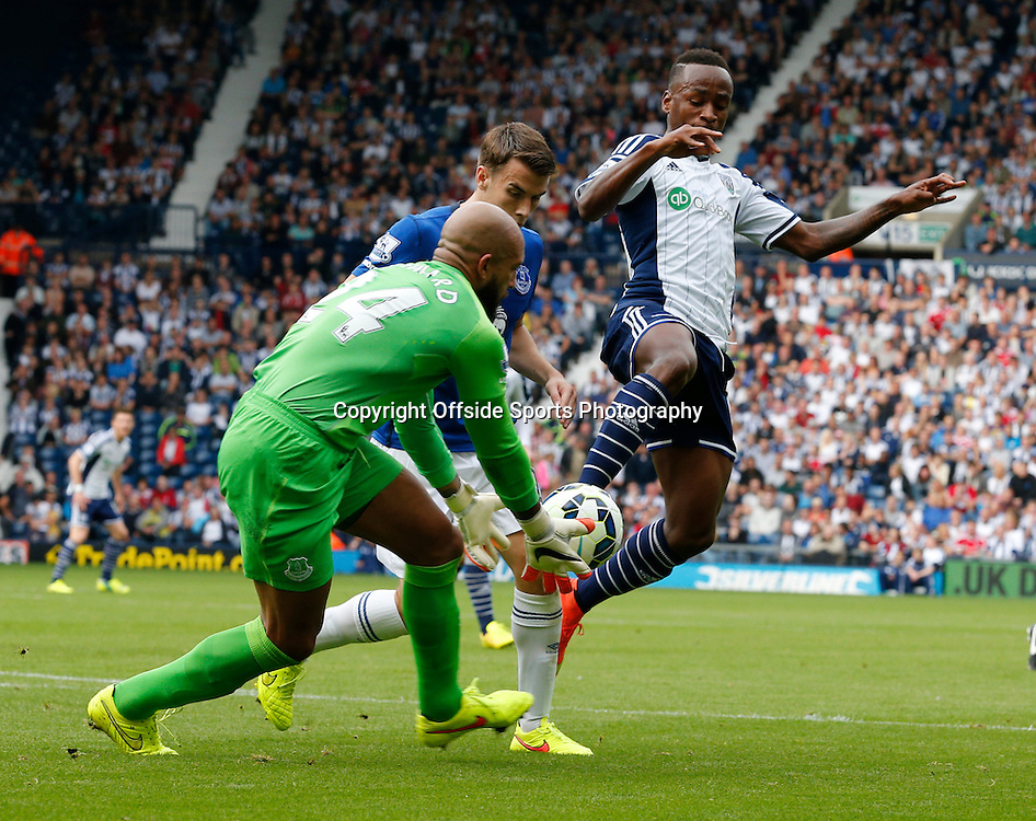 13 September 2014 - Barclays Premier League - West Brom v Everton - West Bromwich Albion's Saido Berahino fouls Tim Howard Going for the Ball - Photo: Paul Roberts / Offside.