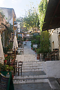 Outdoor dining in the Narrow Mnisikleous street, Plaka, Athens, Greece