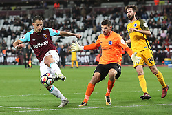 20 October 2017 - Premier League Football - West Ham United v Brighton and Hove Albion - Javier (Chicharito) Hernandez of West Ham passes the ball out wide before Brighton goalkeeper Matthew Ryan can collect it - Photo: Charlotte Wilson / Offside